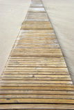 Pathway on the beach. Wooden pathway over the sand of the beach Royalty Free Stock Photos