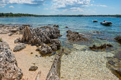 Pathway on the beautiful rocky beach in Istria Stock Photos