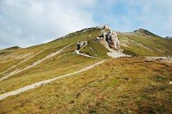 Pathway in Bucegi Mountains. Pathways in Bucegi Mountains ending in high peaks royalty free stock image
