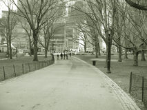 Pathway through Central Park. Black and white scenic view of pathway receding through Central Park with Columbus Circle in background, Manhattan, New York City royalty free stock photography