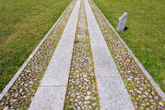 Pathway With Cobblestones and Grass Stock Images