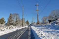 Cleared Pathway During Winter Months. A pathway designed for cyclists and pedestrians has been cleared after a heavy winter snowfall Stock Photo