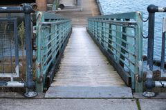 Pathway between docking station and a floating pier. Tunnel view in Portland, Oregon stock photography