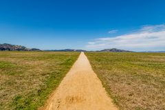 Pathway through Fields. A straight pathway through Crissy Field in San Francisco Stock Photography