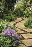 Pathway in flower garden Stock Photo