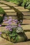 Pathway in flower garden Royalty Free Stock Photo