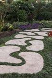 Pathway in flower garden Stock Photos