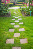 Pathway in garden. Pathway in beautiful flowers garden Stock Photo