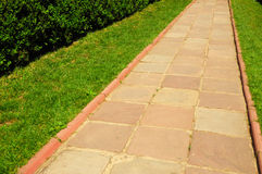Pathway in Garden with concrete bumps. Colorful brick footpath Royalty Free Stock Photography