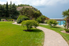 Pathway in gark. Among green meadow Royalty Free Stock Image