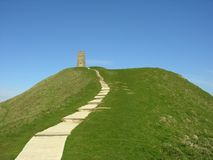 Pathway at Glastonbury Tor. A view of the pathway leading up the historic hill known as Glastonbury Tor to the ancient remains of St. Michael's church tower Stock Photo