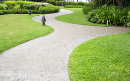 Pathway through a Green City Park Royalty Free Stock Image
