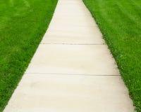 Pathway through green lawn Royalty Free Stock Photo