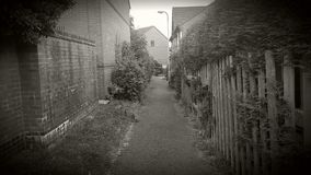 A pathway between houses Royalty Free Stock Photos