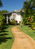 Pathway through landscaped ground at resort Stock Photography