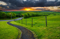 Pathway leading into sunset. A winding pathway leading into the sunset and hills at ashton under lyne , Manchester Royalty Free Stock Image