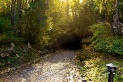 Pathway leading to a cave Stock Photos