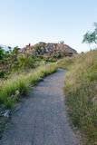 Pathway leading to hilltop. People standing on top of rocky hilltop on Castle Hill, Townsville, Australia Royalty Free Stock Photos