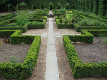 Pathway in a monastery garden. Symmetric view Royalty Free Stock Photo