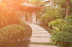Pathway in outdoor of residential building with the Sun rising in the moring. Pathway in outdoor of a residential building with the Sun rising in the moring stock photos