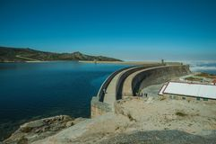 Pathway over dam wall forming a lake on highlands. Pathway over the Marques da Silva concrete dam forming the Long Lake on highlands, in a sunny day at the Serra stock photo