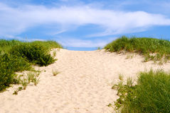 Pathway Over the Dunes. Many footprints in the sand mark a pathway over the dunes at Head of the Meadow Beach, Truro, on the Cape Cod National Seashore Stock Photos