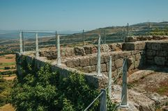 Pathway over stone wall with metal balustrade stock photos