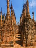 The pathway and the pagoda. The pathway between pagodas which lead to the another pagoda in Kakku ancient pagoda ruin, Myanmar Royalty Free Stock Photos
