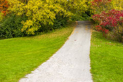 Pathway through park in autumn Stock Images
