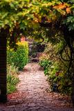 Pathway in a park in autumn. Stony pathway in a public park ( Rookery ) in Streatham in London, summer Stock Image