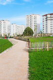 Pathway in the park. Pathway through a park with buildings in the background stock image