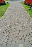 Pathway in park. Concrete block pathway in the park Royalty Free Stock Photo