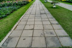 Pathway in park. Concrete block pathway in the park Royalty Free Stock Photos
