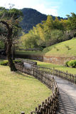 Pathway at Park. A pathway, defined by bamboo fencing, at a garden park Stock Image