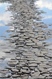 Pathway from pavers among the reflection of clouds Stock Image