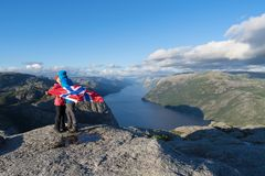Kissing couple on the journey. Pathway Pulpit Rock, Norway. Loving couple kisses on a journey. Panorama of Lysefjord Royalty Free Stock Photos