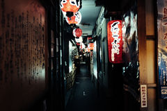 Pathway With Red and White Chinese Lanterns Above Head Stock Image