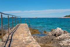 Pathway on the rocky beach in Istria Royalty Free Stock Photography