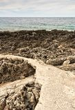 Pathway at a rocky shore Royalty Free Stock Photography