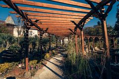 Pathway  in the park. Pathway with roof made of wooden beams in the park Stock Photos