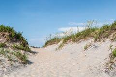 Pathway Through Sand Dunes at Nags Head, North Carolina. Pathway through sand dunes covered in beach grass at Coquina Beach, Cape Hatteras National Seashore Royalty Free Stock Photography
