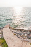 Pathway into the sea. At sunset Royalty Free Stock Photos