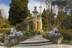 A pathway of stone lions to the pavilion at Sochi arboretum Royalty Free Stock Photo