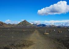 Walking path throw volcanic black sand desert landscape, Laugavegur Trail from Thorsmork to Landmannalaugar, Highlands of Iceland stock photo