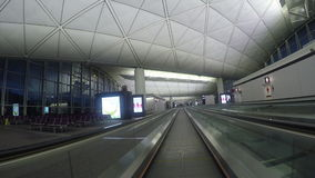 Pathway to gates in Hong Kong Airport on May 20, 2015 in Hong Kong, China stock footage