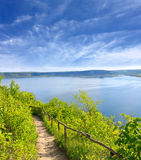 Pathway to lake in nice day Stock Image