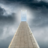 Pathway to paradise. Pathway to the door of paradise in the sky, concept of religion for success or happiness Stock Image