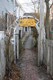 Pathway to Reading. Pathway between two picket fences into a used book store in Provincetown, Massachusetts stock images
