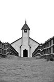 Pathway to Religion. Low view of a pathway and fence leading the viewers eyes to the front of an old wooden church constructed in the Carpenter's Gothic style Stock Photo