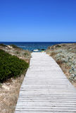 Pathway to the sea. A wooden pathway to access to the sea Royalty Free Stock Photo